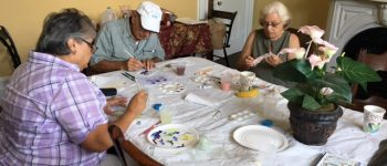 seniors painting at the Woman's Club